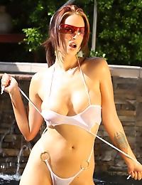 Nikki Nova looking super sassy in her sheer, see-thru bathing suit!