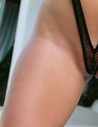 Sophie Dee soaking wet and spilling out of sexy fishnet sling