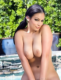 Sultry brunette babe, Aria Giovanni, is stunning in her polka dot bikini that shows off her amazing curves and big boobs, and even better out of it!