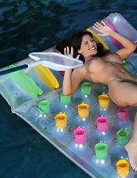 Rebeca Linares floating in sheer pink thong bikini
