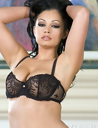 Gorgeous busty brunette, Aria Giovanni, is a sensual dream stripping out of her black bra and panties to nothing but her black high heels!