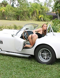 busty babe posing on Cobra car