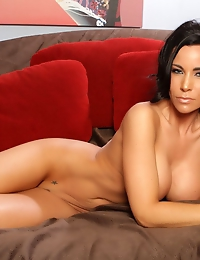 Gorgeous busty  brunette, Laura Lee, shows you just what a wild woman she is stripping out of her leapord skin top and panties!  She's a tigress