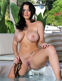 Sophie Dee huge wet wonderful breasts floating in the hot tub